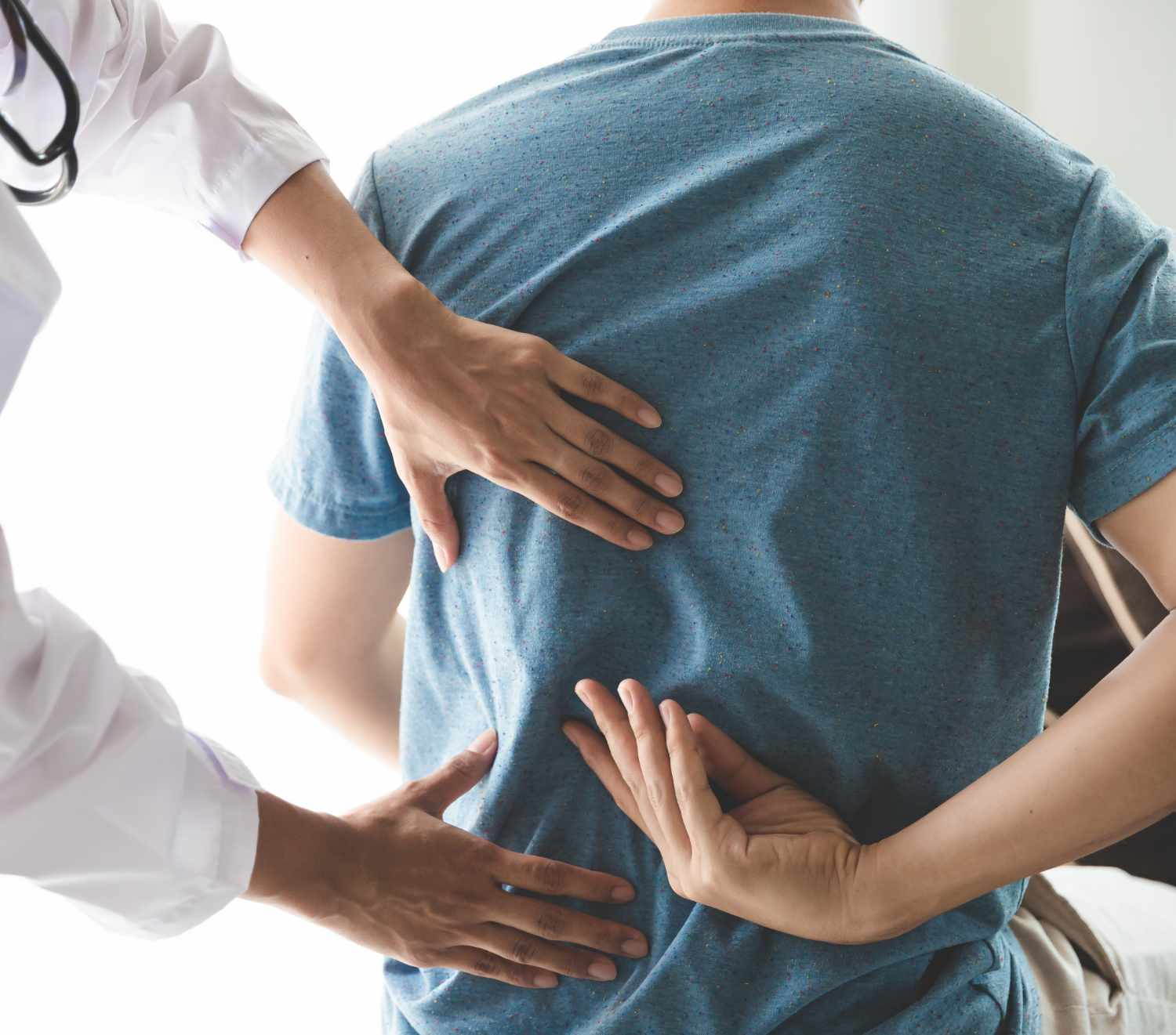 physiotherapist-working-with-patient-in-clinic-clo-8CGQ6AW.jpg
